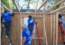 Fairfield Inn & Suites employees help build homes for needy
