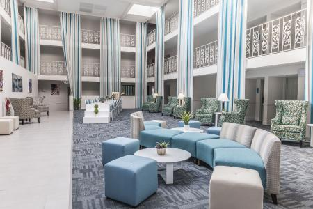 The atrium lobby of the 50-room The Blu, a boutique hotel in Blue Ash, Ohio, opened in October after undergoing extensive renovations and repositioning from a branded midscale hotel.