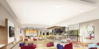 "The lobby design of Hilton Garden Inn's Magnolia prototype for North America aims to create a ""bar-centric focus."""